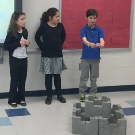 Students work on oyster castle project.
