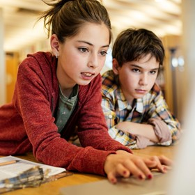 two students working at a laptop computer