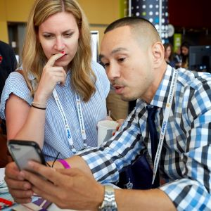 Two educators check out a mobile app.