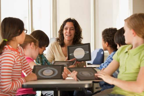 A teacher shares a lesson with her students