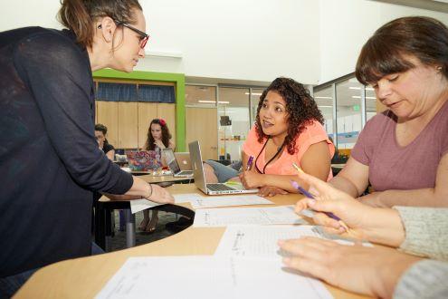 three teachers in a PLC discuss student success