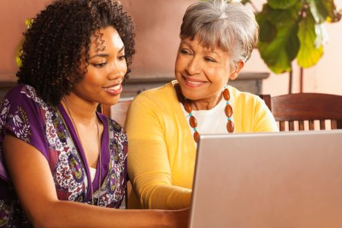 An educator talks to a parent about the benefits of technology