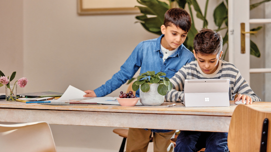 Two students use a tablet