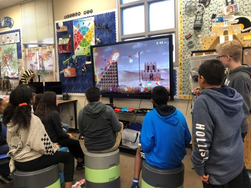 Students play video game in school
