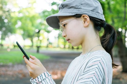 girl looks at her cell phone