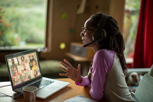 a woman participates in a virtual meeting
