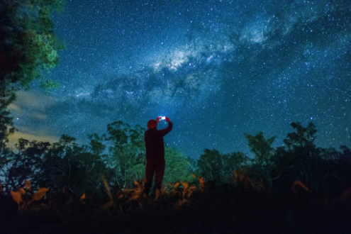 Person takes photo of night sky with smartphone
