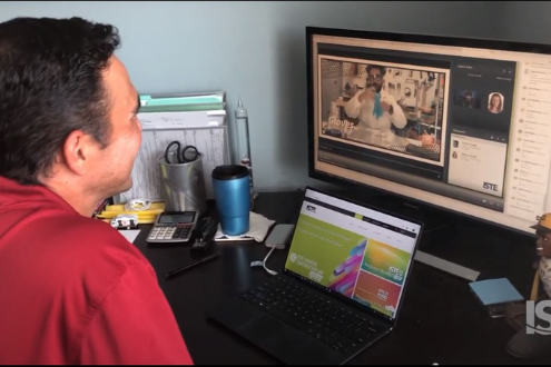 A man watches recordings on his computer of ISTE20 Live