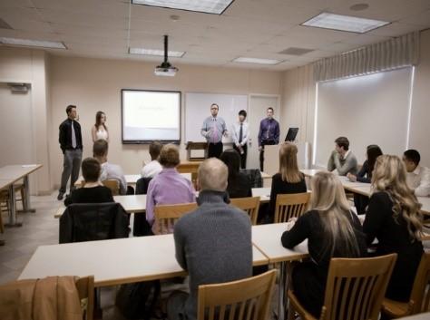 A dozen people attending a school board meeting