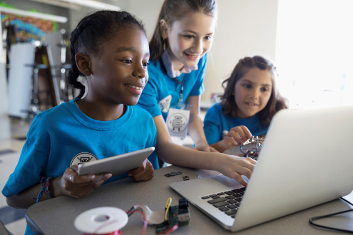 Three girls at a laptop
