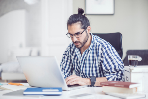 Man looks intently at laptop