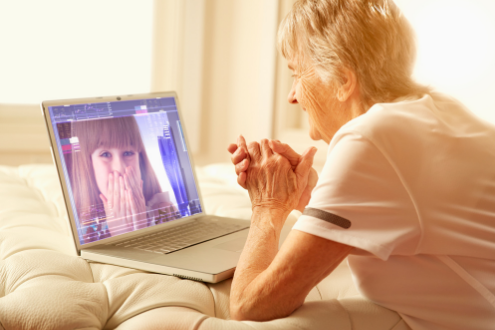 A woman talks to her grand daughter on a video call.