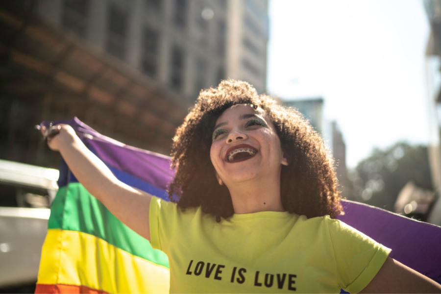 a girl displays a pride flag