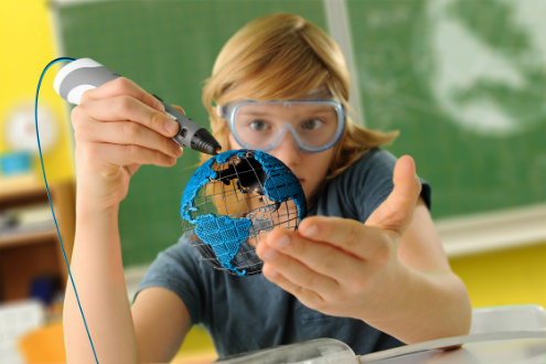 A student wearing safety goggles glues a small globe he created.